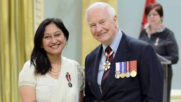 Timmy Sharma, left, receives the Diamond Jubilee medal from Gov. Gen. David Johnston at Rideau Hall on Wednesday.