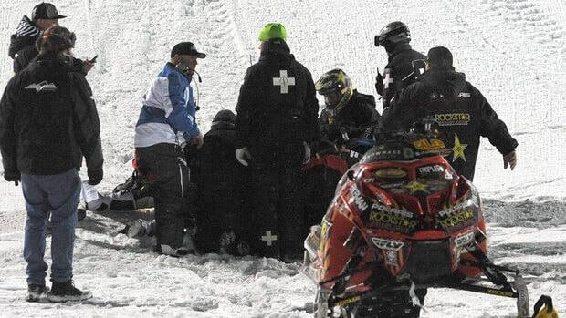 Emergency personnel tend to Caleb Moore after he crashed during the snowmoblie freestyle event at the Winter X Games in Aspen, Colo. on Jan. 24.