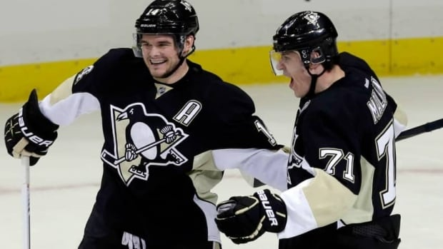 Pittsburgh Penguins' Evgeni Malkin, right, and Chris Kunitz both scored in Game 1 as the Pens drew first blood in their Round 2 series with the Ottawa Senators.