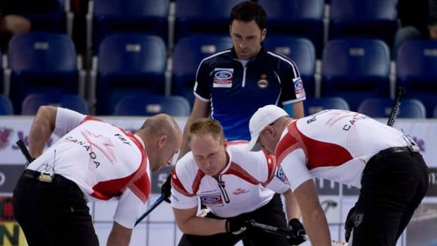 Scotland skip David Murdoch looks on as Canada skip Brad Jacobs, centre, calls the sweeping action of third Ryan Fry, left, and Ryan Harnden during an evening draw at the World Men's Curling Championship in Victoria, B.C., on Sunday.