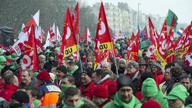 Union members demonstrate against austerity outside an EU summit in Brussels on Thursday.