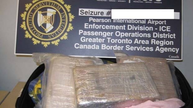 CBSA officers seized these sealed packages of suspected cocaine in a suitcase offloaded from Trinidad and Tobago flight on March 19.
