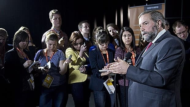 NDP Leader Tom Mulcair speaks to reporters following the party's convention in Montreal. The NDP has voted to take references to socialism out of the party's constitution, a controversial move to modernize that the party had to set aside two years ago.