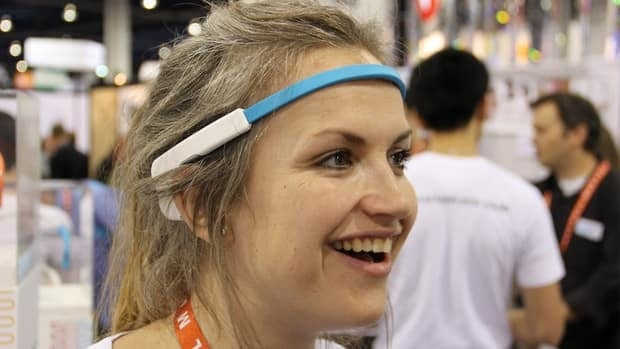 Muse aims to include applications that involve mental health and stress monitoring when it is released in late 2013. Pictured here is an InteraXon employee wearing the Muse headband at the CES.