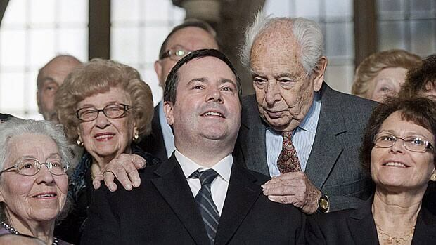 Walter Absil, centre right, and other Holocaust survivors pose for a photograph with Citizenship and Immigration Minister Jason Kenney on Parliament Hill before the National Holocaust Remembrance Day ceremony in Ottawa Tuesday. The government has announced the site for a new National Holocaust Memorial in Ottawa.