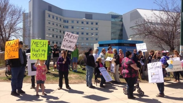 Protesters in front of Saskatoon City Hospital on Saturday were telling people about how they suffered from the side effects of surgical mesh. (Peter Mills/CBC)