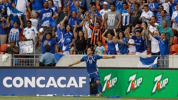 El Salvador's Rodolfo Zelaya celebrates in front of the El Salvador fans after scoring against Haiti during the second half on Monday in Houston.