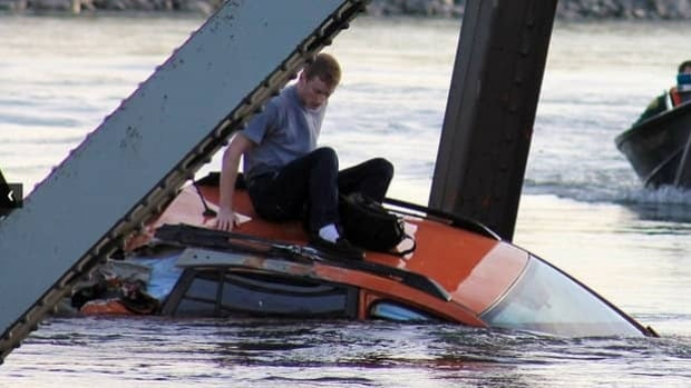 UBC student Bruce Kenning waits to be rescued after the Skagit River Bridge collapsed beneath him.