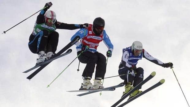 Canada's Tristan Tafel, centre, shown here competing in an event last December, finished second on Sunday in Germany.