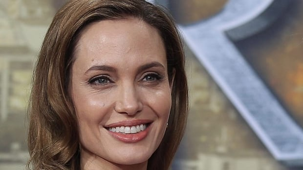 Angelina Jolie appears June 3 in Berlin. A lawsuit reveals News Corp. learned of her affair with Brad Pitt through hacking the phone of her stunt woman in Mr. & Mrs. Smith.