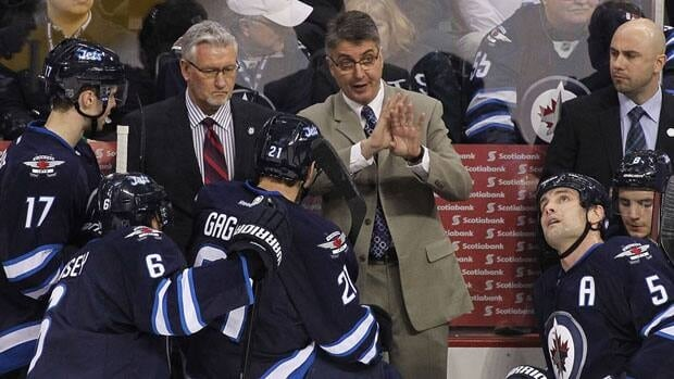 Coach Claude Noel speaks to the Winnipeg Jets during a game.