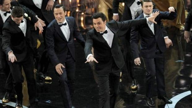 "Seth MacFarlane, seen here dancing between Joseph Gordon-Levitt and Daniel Radcliffe, has said he had a ""lotta fun"" hosting the Oscars"