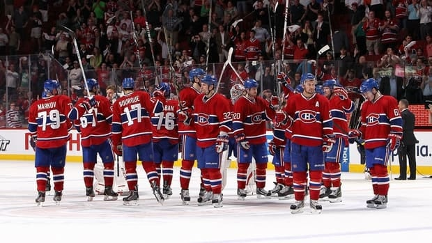 Montreal Canadiens salute the crowd at centre ice after being eliminated by the Ottawa Senators.