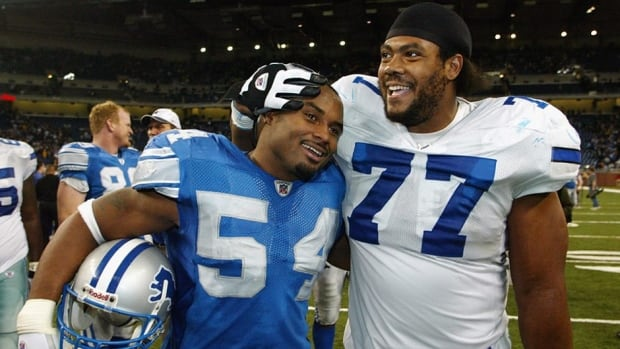 Former NFL linebacker Barrett Green, seen here with the Detroit Lions, shares a smile with Dallas Cowboys' Solomon Page after a game in 2002. Green says he was targeted by the Washington Redskins during a game on Dec. 5, 2004, resulting in a career-ending knee injury.