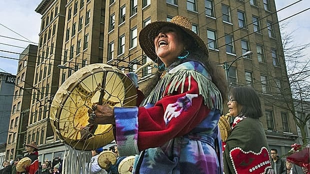 A First Nations woman drums and sings in the annual Women's Memorial Day March in Vancouver last year. Both a political and spiritual event, the march is held to remember women who have died because of physical, mental, emotional and spiritual abuse.