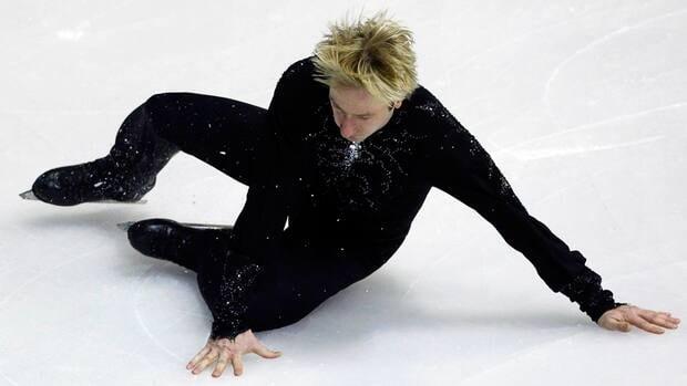 Russia's Evgeni Plushenko falls during his performance in the men's short program at the European Figure Skating Championships on Thursday.
