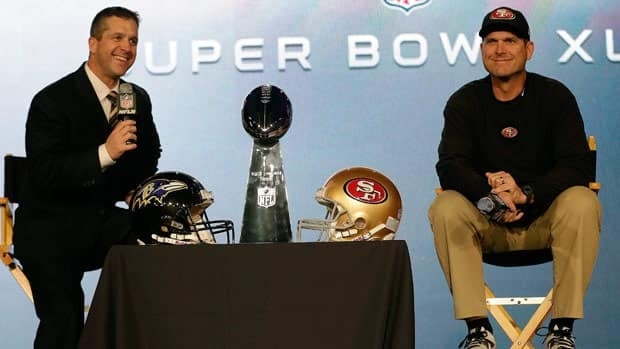 Baltimore Ravens head coach John Harbaugh, left, and San Francisco 49ers head coach Jim Harbaugh answered questions in New Orleans on Friday.