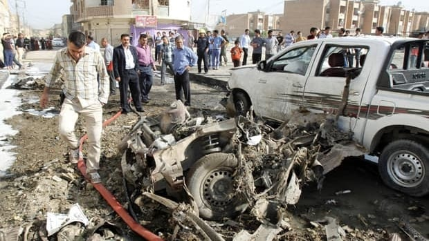 Iraqi security personnel are seen at the site of a bomb attack in Kirkuk, 290 km north of Baghdad, on April 15. A series of early morning explosions hit cities across Iraq on Monday.
