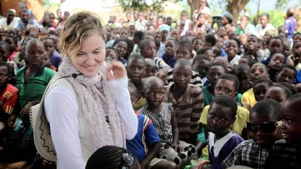 Madonna, seen visiting school children in Chorwe, Malawi last week, has drawn a blast of criticism from the southern African nation's president.