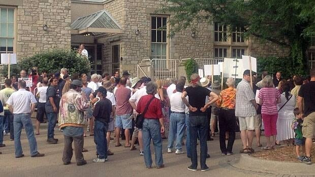 People rallied outside Mackenzie Hall to protest plans to develop Ojibway Shores.