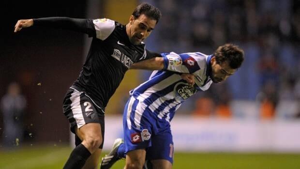 Malaga's defender Jesus Gamez, left, vies with Deportivo Coruna's Portuguese midfielder Bruno Gama at the Municipal de Riazor stadium in La Coruna on Saturday.