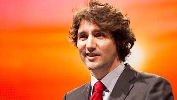 Liberal leadership hopeful Justin Trudeau, seen here speaking at the Reviving the Islamic Spirit conference in Toronto last December, has outpacing all other contenders in fundraising with three months to go in the Liberal leadership race.