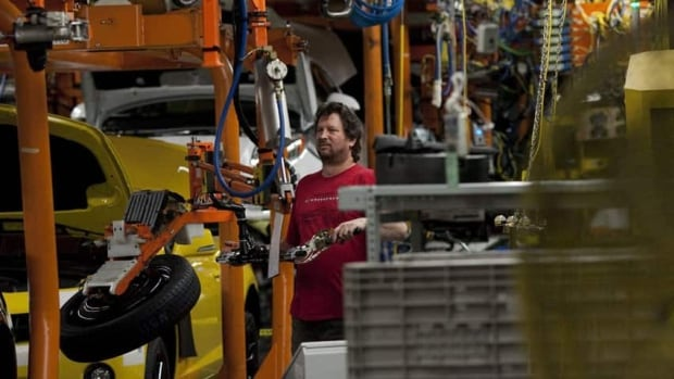 An assembly line worker at the General Motors Assembly plant in Oshawa. A court has ruled GM cannot unilaterally cut retiree benefits for workers.