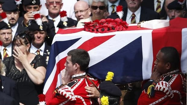 The coffin of Fusilier Lee Rigby is carried by members of his regiment after his funeral service at the parish church in northern England on July 12. Prime Minister David Cameron is among the mourners paying their respects to the Afghanistan war veteran hacked to death on a busy street in London.