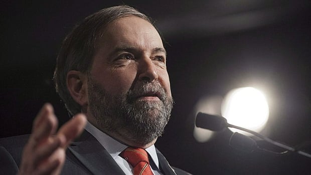 """NDP leader Tom Mulcair has been accused of """"trash talking"""" Canada during his trip to New York and Washington and undermining efforts to win approval for the Keystone XL pipeline."""