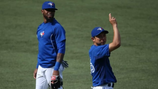 The Toronto Blue Jays sent down Munenori Kawasaki, right, to make room for Jose Reyes who returns from an ankle injury sustained in April.