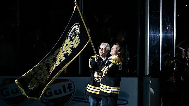 "William and Patricia Campbell, parents of Krystle Campbell, who was killed in the Boston Marathon bombings, are shown waving a ""Boston Strong"" banner before Game 4 of the Eastern Conference final on June 7."