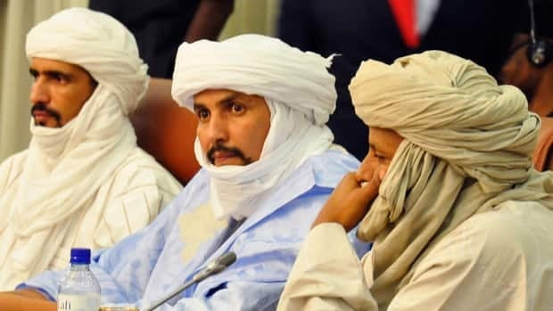 Ansar Dine delegates attend a mediation meeting with the Malian government in December. The Islamist group said Friday it was suspending a ceasefire that lasted less than a month.
