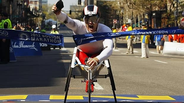 Canadian Josh Cassidy crosses the line in first place at the Boston Marathon last year. Wheelchair athletes in Hong Kong are disappointed they only have a half-marathon at this Sunday's race.