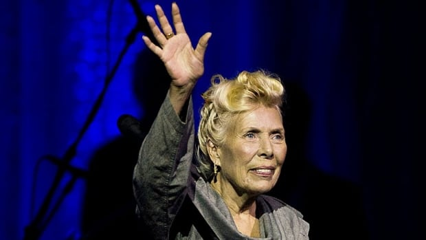 Joni Mitchell waves to the crowd during her 70th birthday tribute concert as part of the Luminato Festival at Massey Hall in Toronto on Tuesday June 18, 2013.