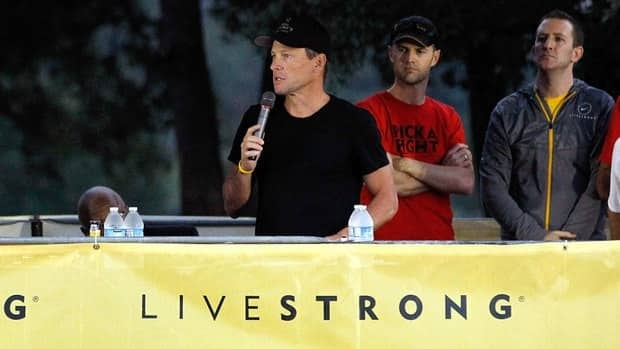 In this Oct. 2012 file photo, Lance Armstrong addresses participants at the Livestrong Challenge Ride in Austin, Texas. A source says the cyclist apologized to the cancer foundation's staff Monday and also said he would try to restore its reputation.