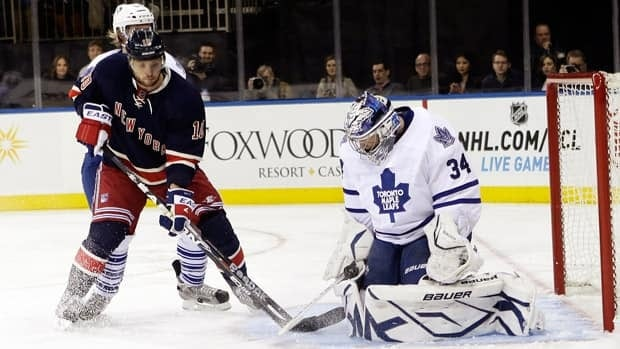 Despite an early advantage, goaltender James Reimer, right, and the Toronto Maple Leafs failed to hold off the dominating New York Rangers.