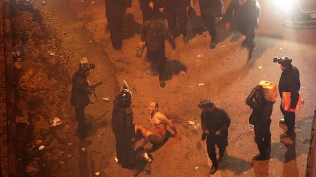 Video of Egyptian riot police beating a naked man during protests on Friday was broadcast live throughout the country.