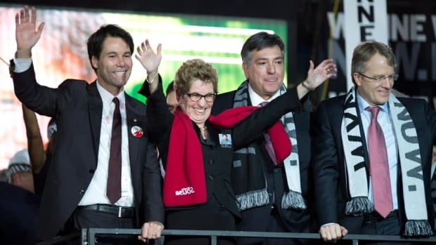 Kathleen Wynne celebrates with fellow candidates Eric Hoskins (left), Gerard Kennedy (right) and Charles Sousa after they gave her their support at the Ontario Liberal Party convention in Toronto on Saturday.