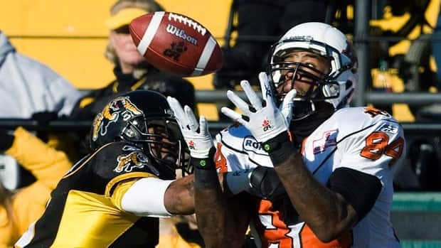 B.C. Lions wide receiver Emmanuel Arceneaux, right, makes a catch during a 2010 CFL game in Hamilton.