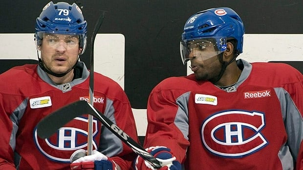 Montreal Canadiens defenccemen P.K. Subban, right, and Andrei Markov have played very few playoff games together, owing to Markov's long battles with knee injuries.