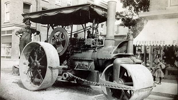 Any shenanigans going on here? Judge Snider looked at everything the works department was doing a century ago. This fellow is leveling gravel on Barton East near Wentworth.