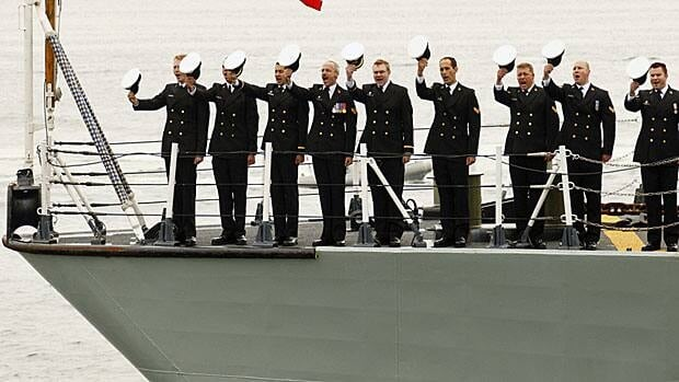Crew from the Canadian frigate HMCS St. John's salute while part of an international naval review in Halifax in 2010. Canada's aging frigates and destroyers are to be replaced under a proposed $25 billion program.