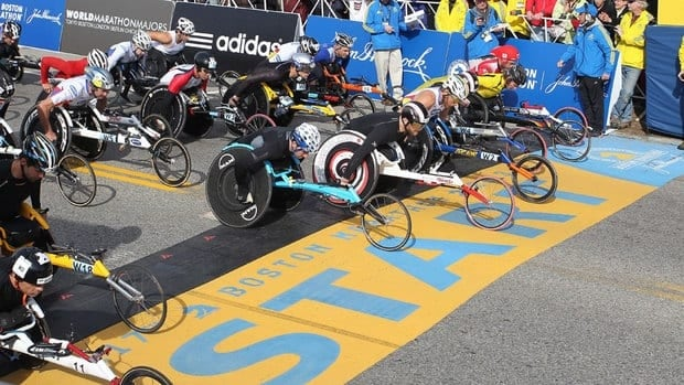 Canadian Josh Cassidy (front row, fifth from right, in white chair) lined up to defend his Boston Marathon title on Thursday morning. Hours later, the event would be forever altered.