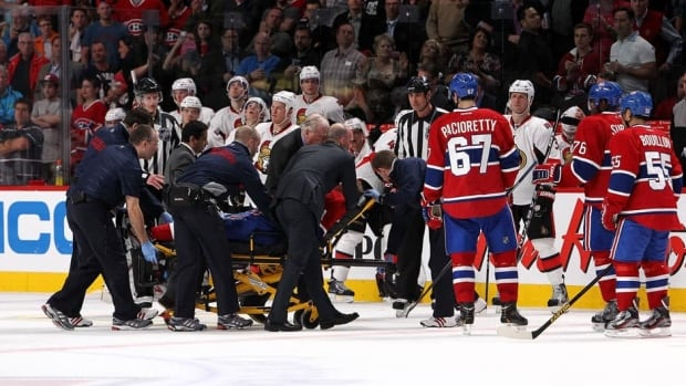 Lars Eller (81) of the Canadiens is taken off the ice on a stretcher after being hit by Eric Gryba of the Ottawa Senators, not shown, during Game 1 of the Eastern Conference quarter-finals at the Bell Centre on Thursday in Montreal.