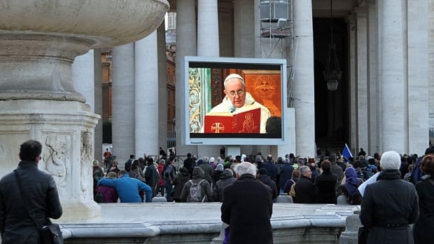 Thousands of people watch Pope Francis deliver his first mass in St. Peter's Square the day after he was elected in a secret ballot.