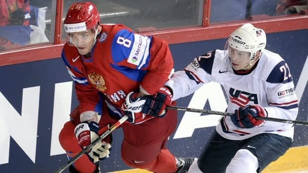 Russia's Alexander Ovechkin, left, vies for the puck with USA's Matt Hunwick during the 2013 Ice Hockey IIHF World Championships Group B Quarterfinal match Russia vs USA in Helsinki, Finland on Thursday May 16, 2013. (AP Photo/LEHTIKUVA / Martti Kainulainen) FINLAND OUT