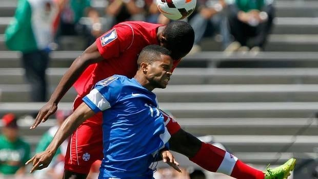 Canada defender Doneil Henry, above, heads the ball over Martinique forward Kevin Parsemain (17) in the first half during a CONCACAF Gold Cup soccer match on Sunday. Tiny Martinique won the game.