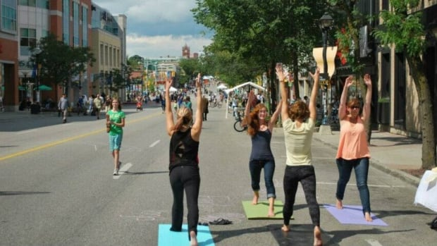 Street yoga at one of the Open Streets Uptown Waterloo events in 2013. The first Open Streets of 2014 takes place on June 15.