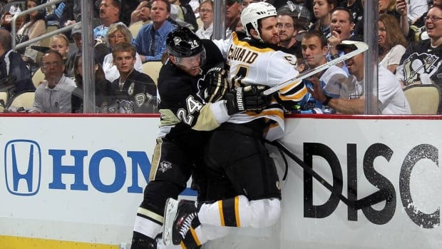 Penguins forward Matt Cooke, left, delivered a hit-from-behind to Boston Bruins defenceman Adam McQuaid, right, during Game 1 of the Eastern Conference final Saturday night at Consol Energy Center.