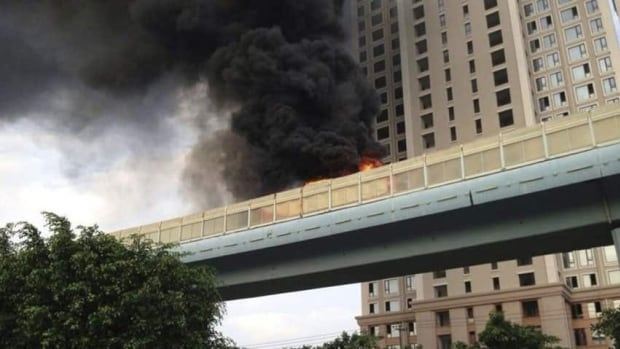 Smoke emits from a bus on fire in Xiamen, Fujian province, on Friday. The fire on a elevated bus lane killed at least 47 people.
